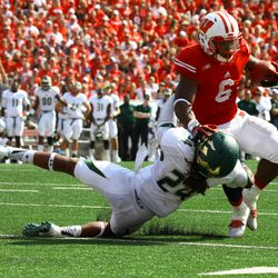Corey Clement stiff arms South Florida defensive back Johnny Ward