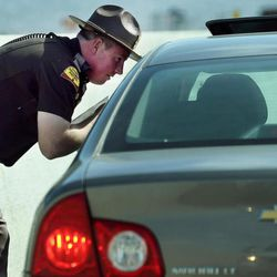 Trooper Nick Swallow talks with a driver after pulling them over for speeding.