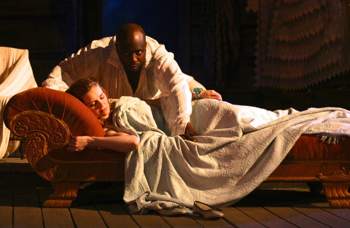 """Kate McDermott and James Earl Jones II in a scene from First Folio Theatre's production of """"Cymbeline: A Folk Tale with Music."""""""