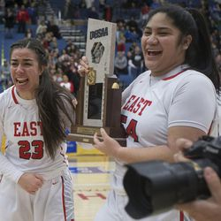 East's Liana Kaitu'u and Lani Taliauli celebrate following the Leopards' 68-48 victory against Timpview in the Class 5A state championship game at Salt Lake Community College in Taylorsville on Saturday, Feb. 24, 2018.