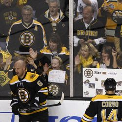 Boston Bruins fans watch during warm ups prior to facing the Washington Capitals in Game 2 of an NHL hockey Stanley Cup first-round playoff series in Boston, Saturday, April 13, 2012.