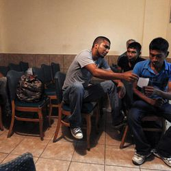 Several immigrants, many of them Mexican citizens, gather in a chapel area at a well known immigrant shelter, as many are making tough decisions on whether to try their luck at trying to make it to the United States, by illegally crossing the border, Thursday, Aug. 9, 2012, in Nogales, Mexico.  Many of them have already been caught in the United States and been shipped back to Mexico before.