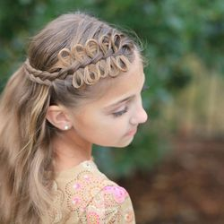 """The Cute Girls Hairstyle original Bow Braid hairstyle, as seen in """"The Hunger Games: Catching Fire."""""""