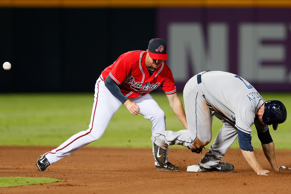 Elliot Johnson trying to tag out Chase Headley on a steal while Magic Flying Ball floats far away.