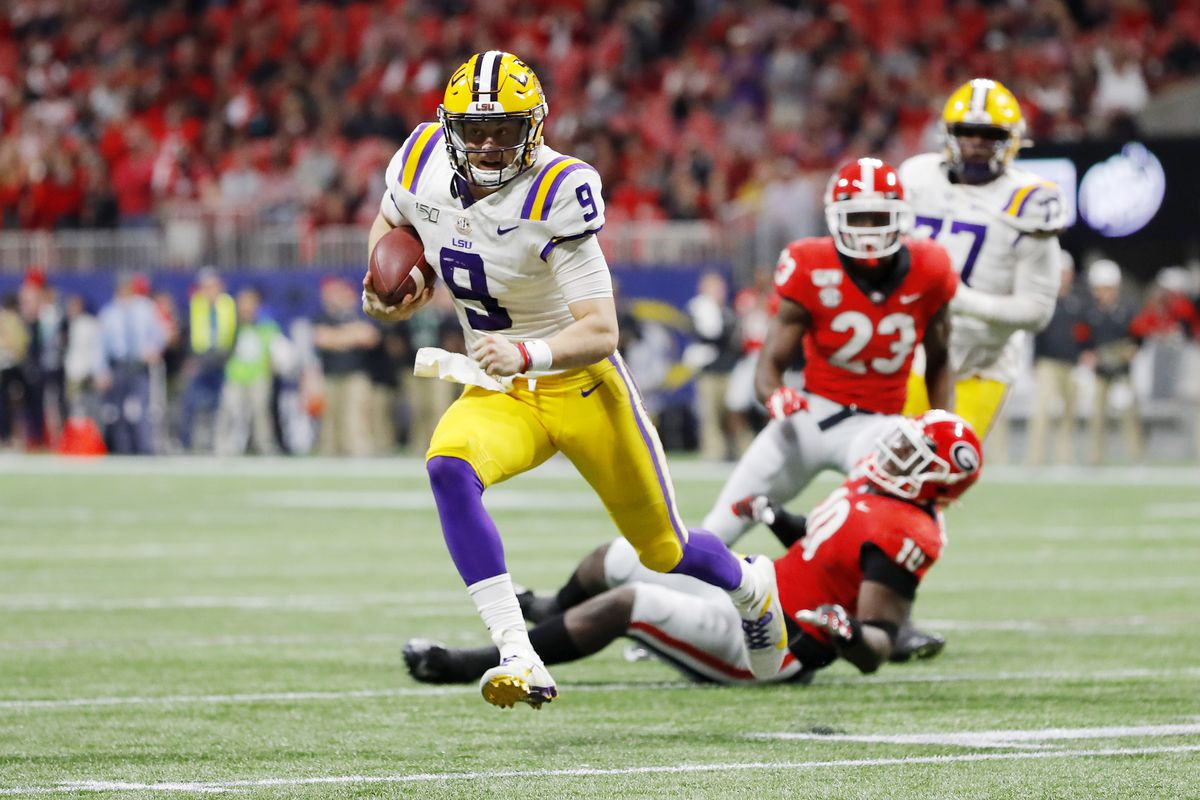 Joe Burrow of the LSU Tigers runs with the ball in the second half against the Georgia Bulldogs during the SEC Championship game at Mercedes-Benz Stadium on December 07, 2019 in Atlanta, Georgia.