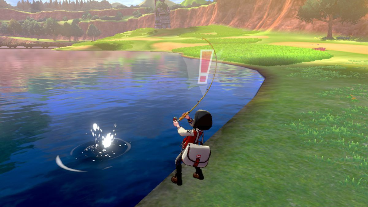 A Pokémon trainer reels in a fish