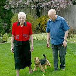Leslie Norris and his wife, Kitty, walk their dog, Tansi. Norris says he gets most of his inspiration while walking.