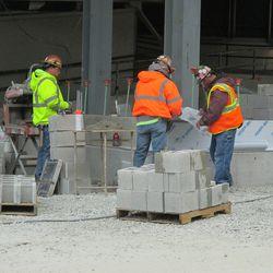 2:55 p.m. Concrete blocks being put up along the Waveland Avenue side of the main bleacher entrance -