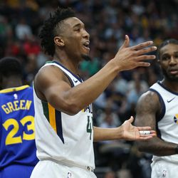 Utah Jazz guard Donovan Mitchell (45) celebrates after scoring on the Golden State Warriors at Vivint Arena in Salt Lake City on Tuesday, April 10, 2018.