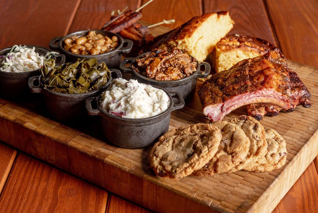 """A """"pork paradise"""" platter comes with half a rack of ribs, half a pound of pulled pork, and bacon lollipops"""