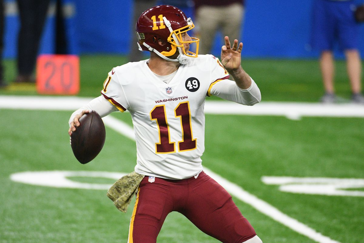 Washington Football Team quarterback Alex Smith (11) throws a pass against the Detroit Lions during the first quarter at Ford Field.