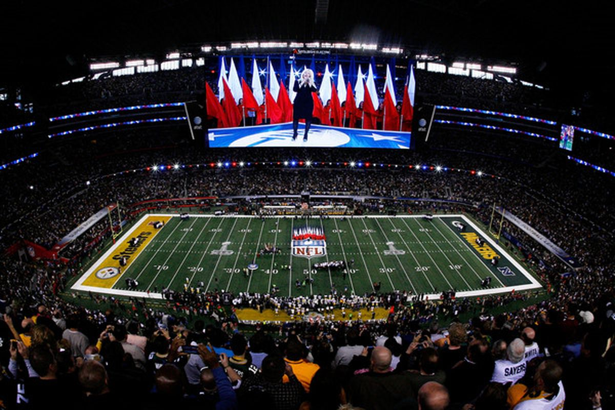 ARLINGTON TX - FEBRUARY 06:  Singer Christina Aguilera performs the national anthem during Super Bowl XLV at Cowboys Stadium on February 6 2011 in Arlington Texas.  (Photo by Tom Pennington/Getty Images)