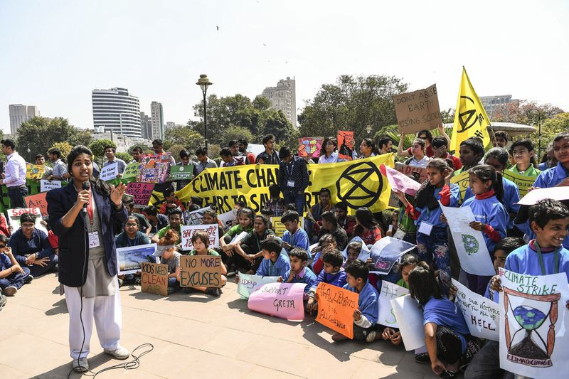 Indian school students hold placards as they take part in a protest against global warming in New Delhi on March 15, 2019.