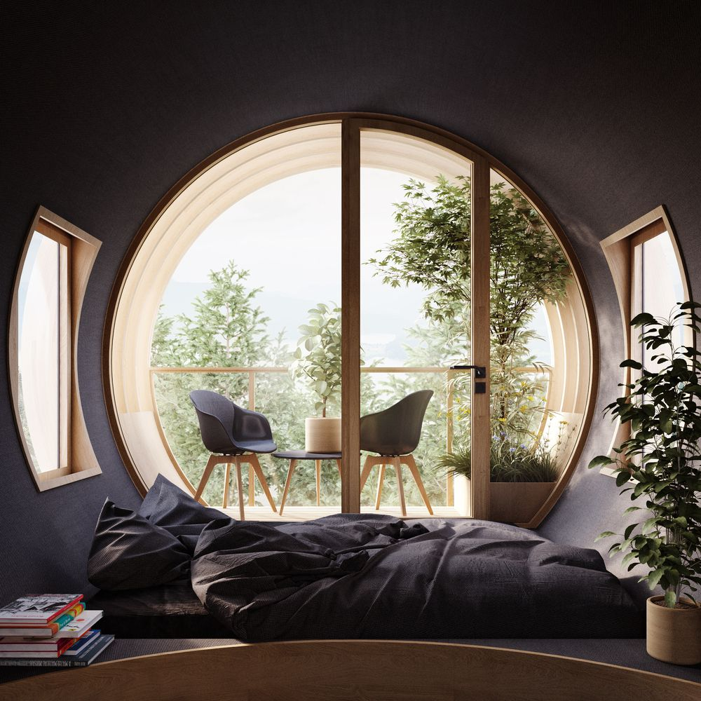 Interior of treehouse with dark walls and large circular window