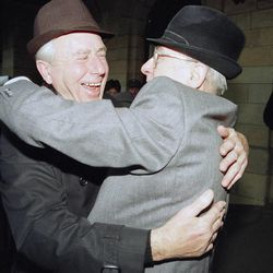 In this Nov. 10, 1989, file photo,  two men from West and East Germany meet again and embrace each other after the arrival of a special train from Magdeburg at Helmstedt railway station. The Berlin Wall came down Nov. 9, 1989, heralding not just the reunification of East and West Berlin, and East and West Germany, but the eventual fall of the USSR and the Iron Curtain.