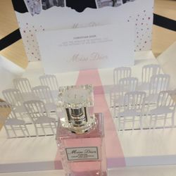 """On my desk is a pristine pop-up """"wedding invitation"""" for the """"only daughter"""" to the late designer Christian Dior: Miss Dior—the hair mist edition (out in March)."""