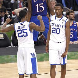 Kentucky guard Marquis Teague (25) and guard Doron Lamb (20) react during the second half of the NCAA Final Four tournament college basketball championship game against Kansas, Monday, April 2, 2012, in New Orleans.