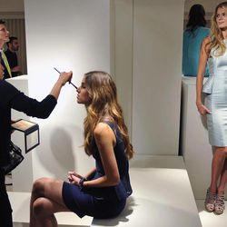 Make-up is applied during the Elie Tahari Spring 2013 presentation  during Fashion Week in New York, Monday Sept 10, 2012.