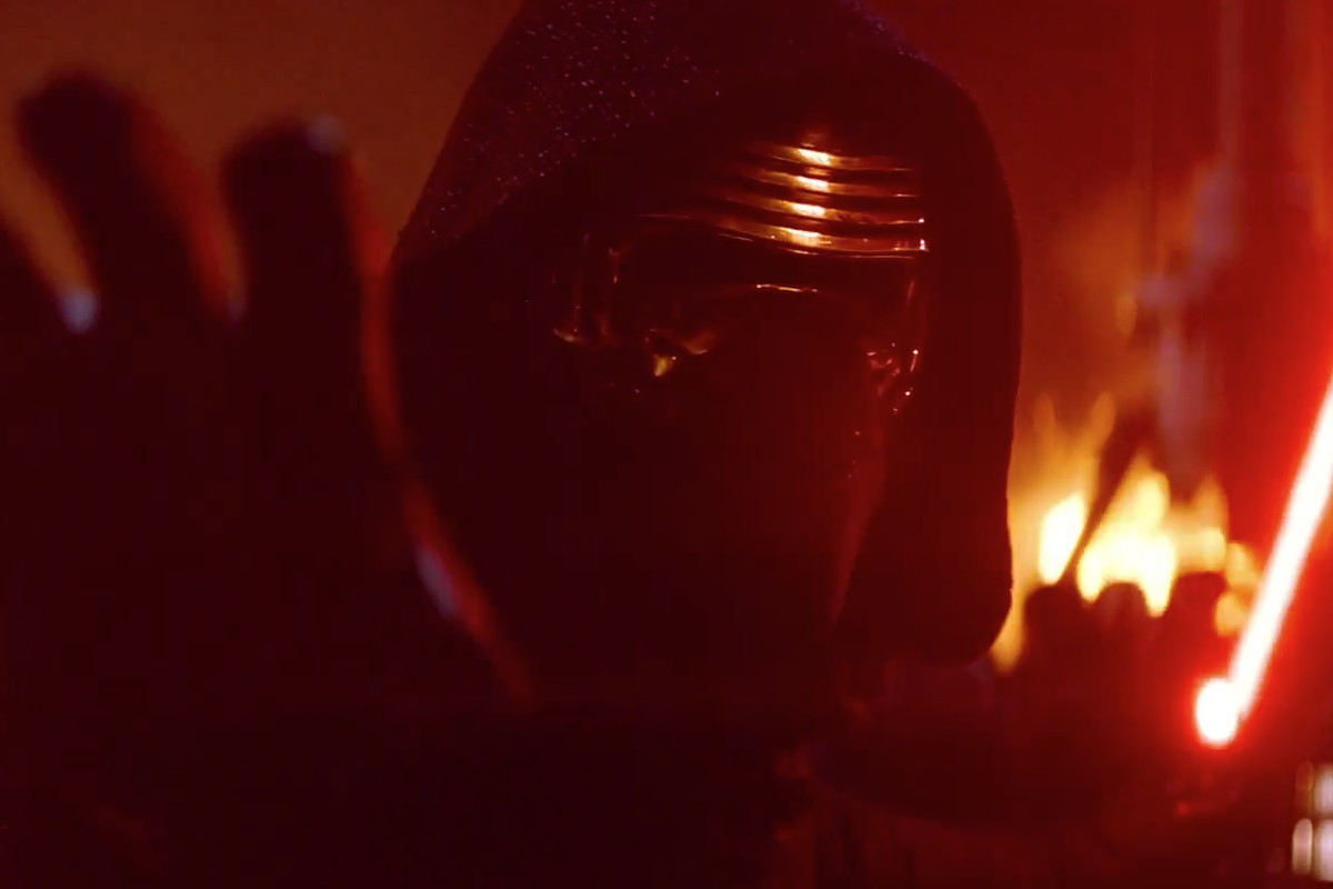Kylo Ren holding his lightsaber and using the Force in Star Wars: The Force Awakens