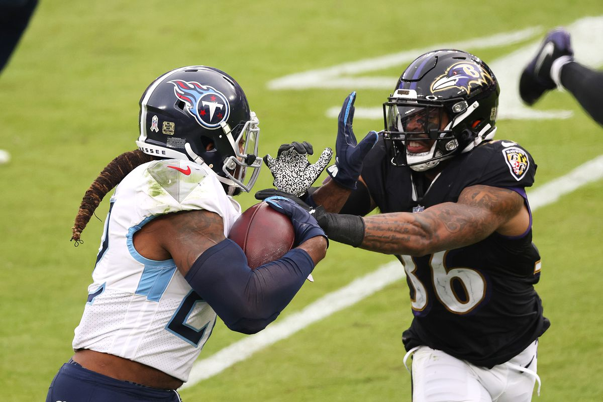 Derrick Henry #22 of the Tennessee Titans carries the ball against Chuck Clark #36 of the Baltimore Ravens during the game at M&T Bank Stadium on November 22, 2020 in Baltimore, Maryland.