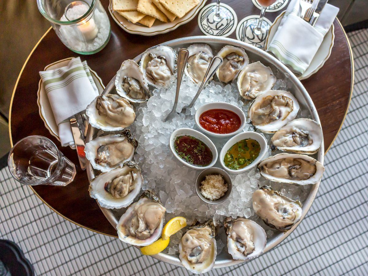 State of Grace's $1 oysters are one of the best deals in town.
