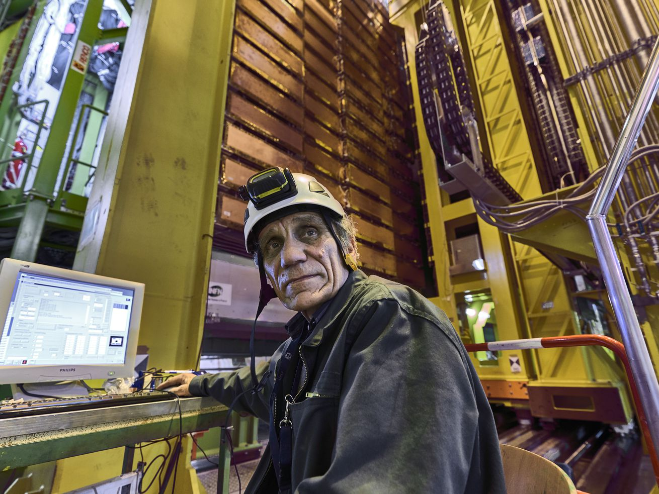 In this 2018 photo made available by CERN, Nikolai Bondar works on the LHCb Muon system at the European Organization for Nuclear Research Large Hadron Collider facility outside of Geneva.