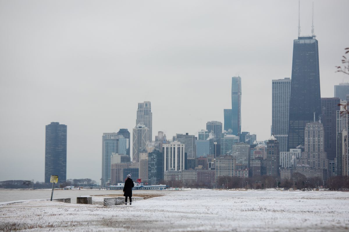 A person walks along the Lakefront Trail on Sunday, Jan. 12, 2020, a day after a major winter storm hit Chicago.