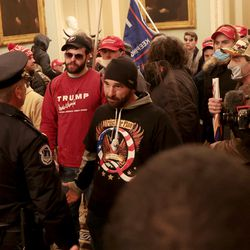Protesters interact with Capitol Police inside the U.S. Capitol Building on January 06, 2021 in Washington, DC. Congress held a joint session today to ratify President-elect Joe Biden's 306-232 Electoral College win over President Donald Trump. A group of Republican senators said they would reject the Electoral College votes of several states unless Congress appointed a commission to audit the election results.