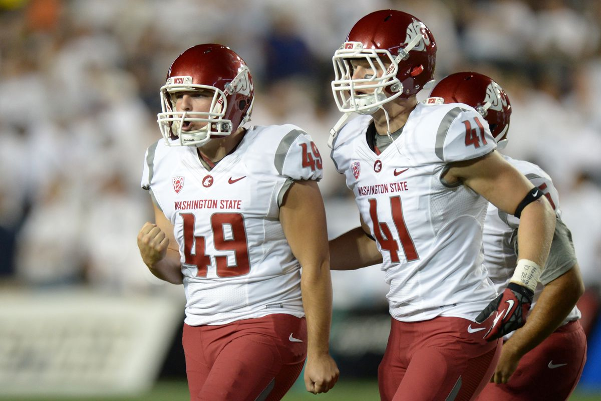 Aug 30, 2012; Provo, UT, USA; Washington State Cougars kicker Andrew Furney (49) reacts with wide receiver Max Hersey (41) after kicking a field goal during the second quarter at Lavell Edwards Stadium. Mandatory Credit: Jake Roth-US PRESSWIRE