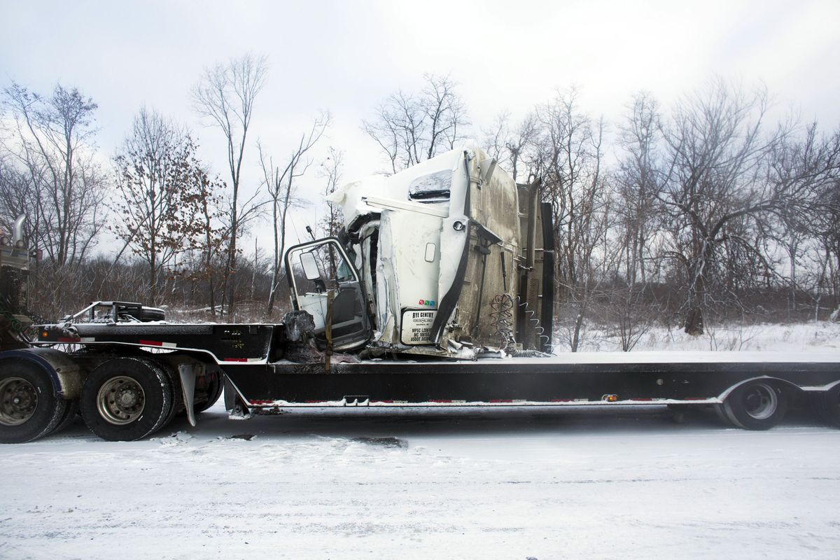 <small><strong>Road crews work to clear wrecked vehicles and debris along Interstate 94, Saturday, Jan. 10, 0215, the day after a series of crashes closed the highway between mile markers 88 and 92 in eastern Kalamazoo County, near Galesburg, Mich. | Chri