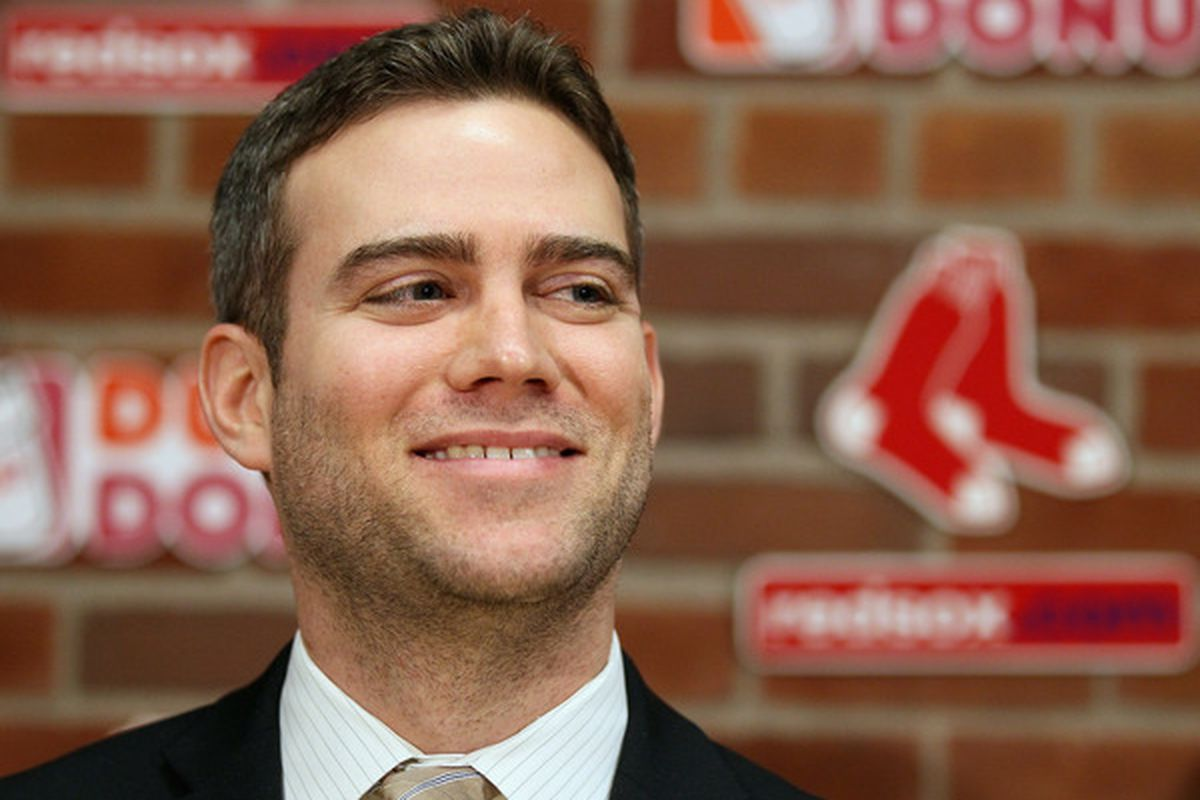 Theo Epstein general manager of the Boston Red Sox, contemplates the destruction of his enemies and the lamentations of their women. (Photo by Elsa/Getty Images)