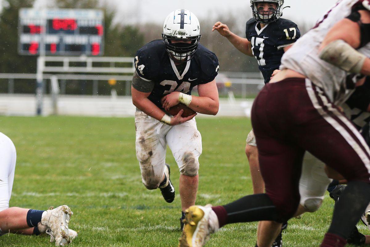 Cary Grove's Nicholas Hissong (34) runs through a big hole to score his second touchdown against Prairie Ridge.