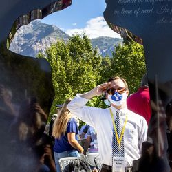 Stephen Allen, younger brother of 1st Lt. Kage Allen, U.S. Air Force, mimics the salute silhouette on the Gold Star Families Memorial Monument in North Ogden on Saturday, Aug. 1, 2020.