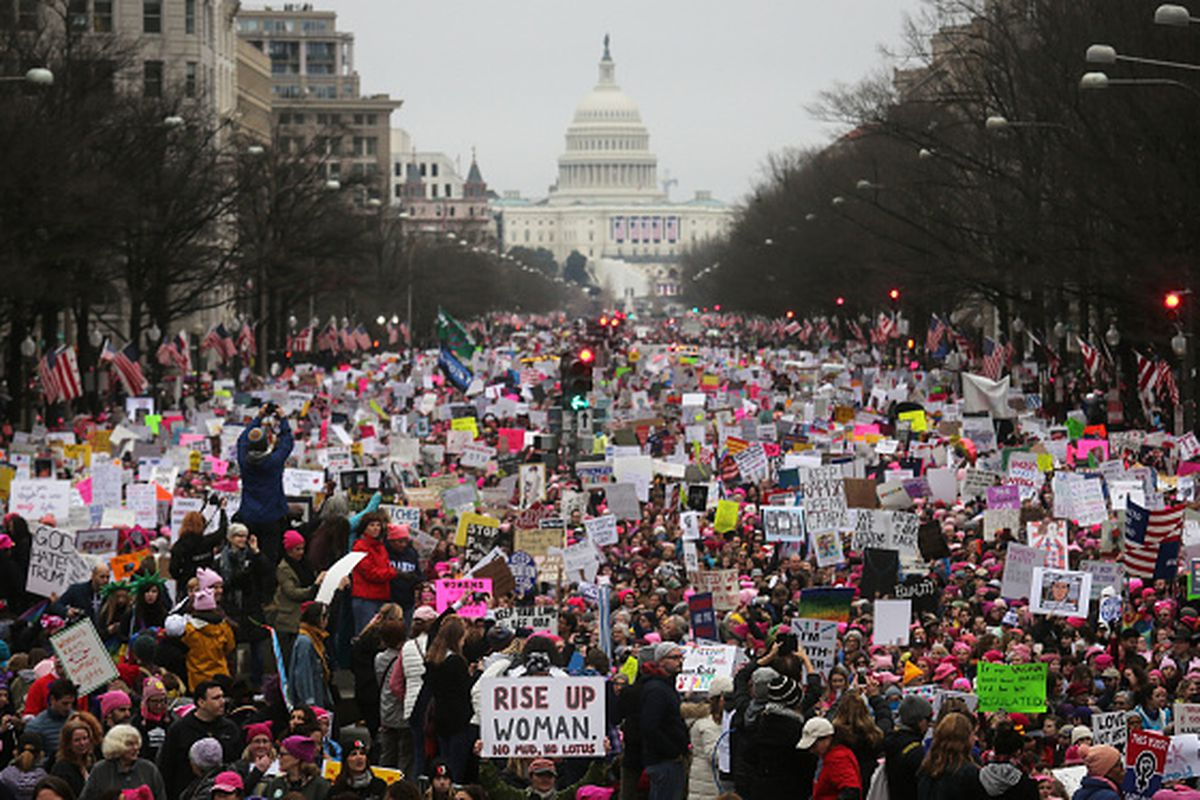 Protesters walk during the Women's March on Washington, DC.