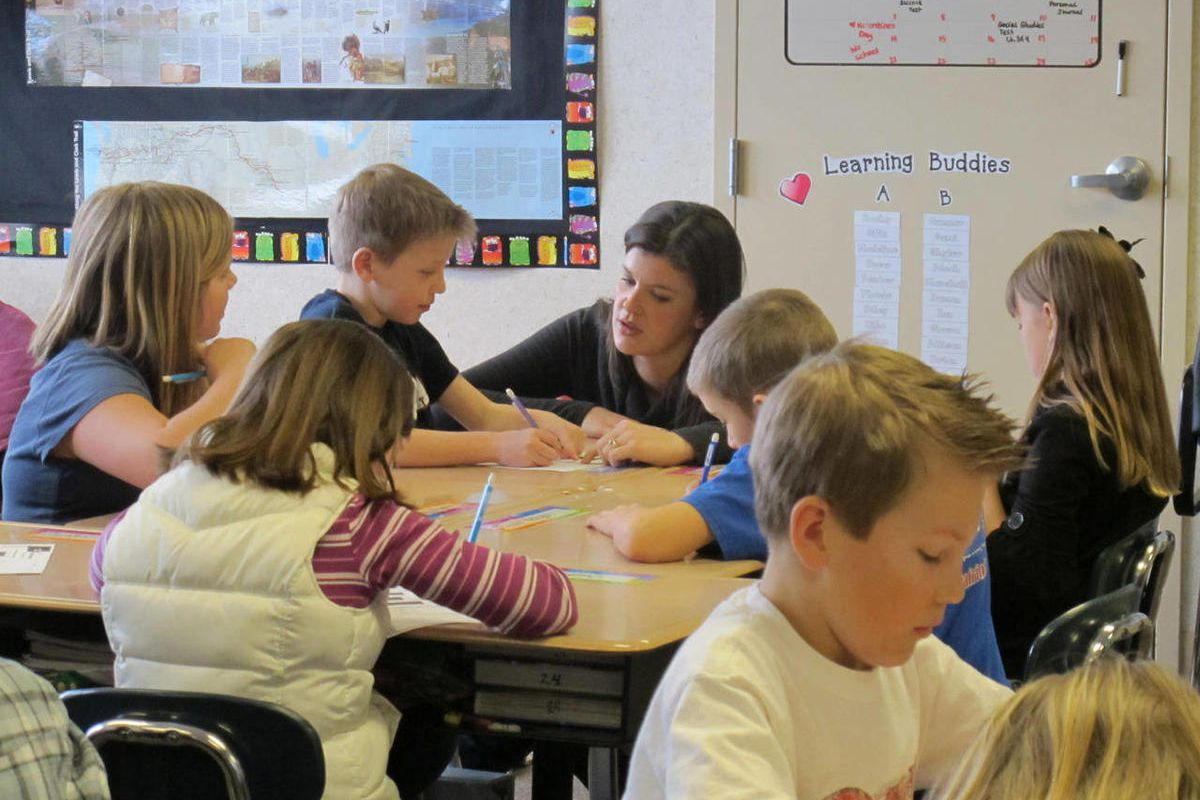 In this photo taken Wednesday, Feb. 23, 2011, Lindsay Ehlers teaches math to her fourth grade class at Liberty Lake Elementary School in Liberty Lake Washington.