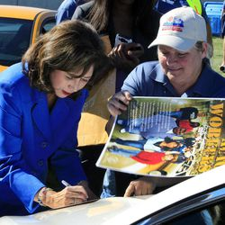 U.S. Secretary of Labor Hilda Solis signs autographs outside the Flat Rock Assembly in Flat Rock, Mich., Monday, Sept. 10, 2012. The plant, formerly known as AutoAlliance International will continue to produce the Mustang and add the Fusion next year. Flat Rock Assembly will be the U.S. producer of the Fusion, employing 2,900 workers on both vehicle lines.