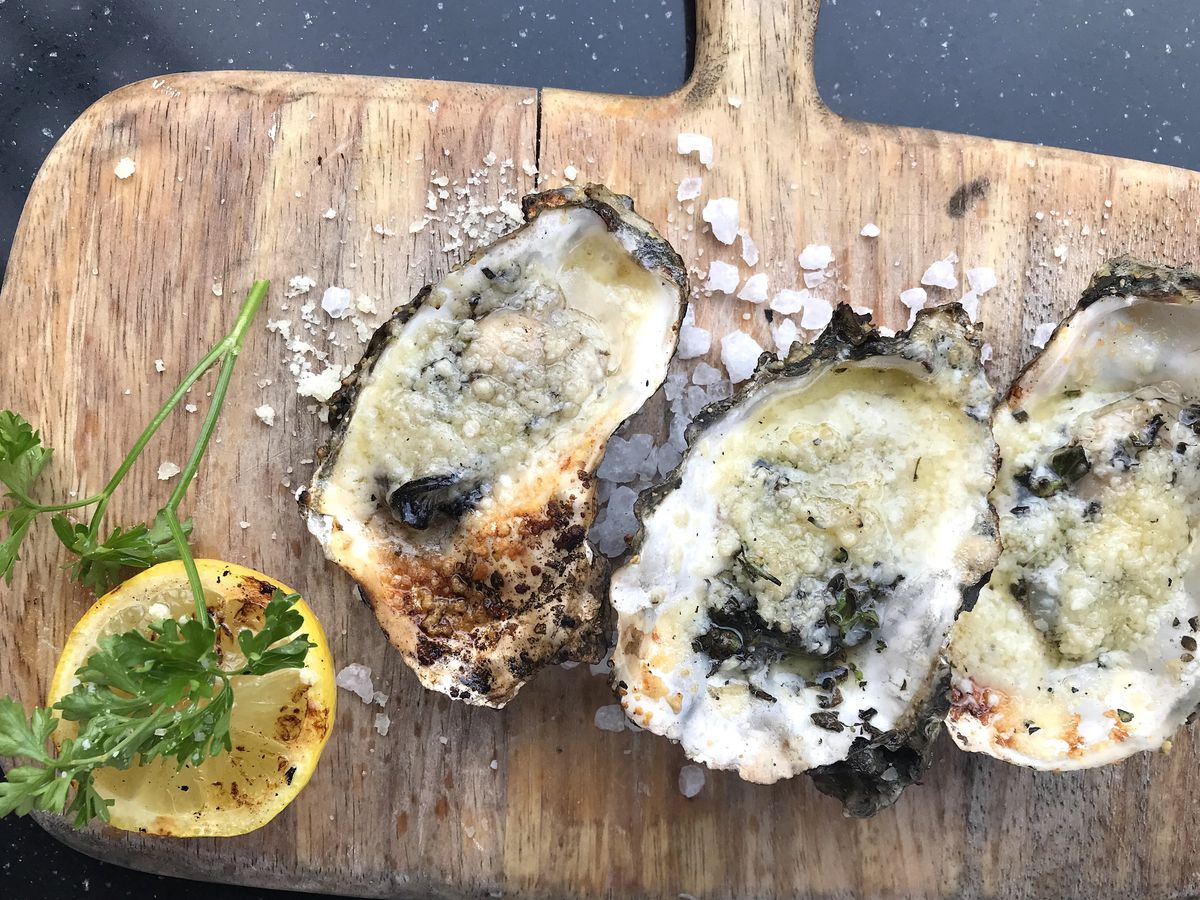 Broiled oysters with garlic butter and parmesan