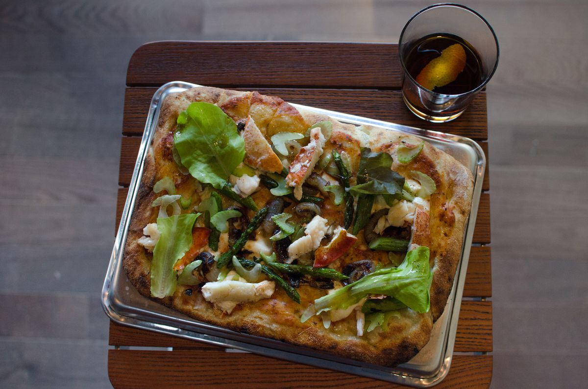 T&B Pizza's lobster and butter Roman-style pizza with shaved celery, asparagus, crème fraîche, and brown butter. A Negroni on the side (Ford's Gin, Punt e Mes, Cynar, Dolin Blanc, orange twist).