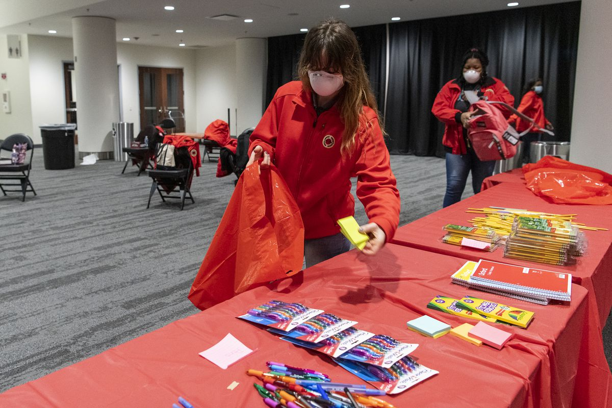AmeriCorps members from City Year Chicago sorted and packed donated school supplies at Wintrust Arena on Monday, Jan. 18, 2021 for Martin Luther King Jr. Day.