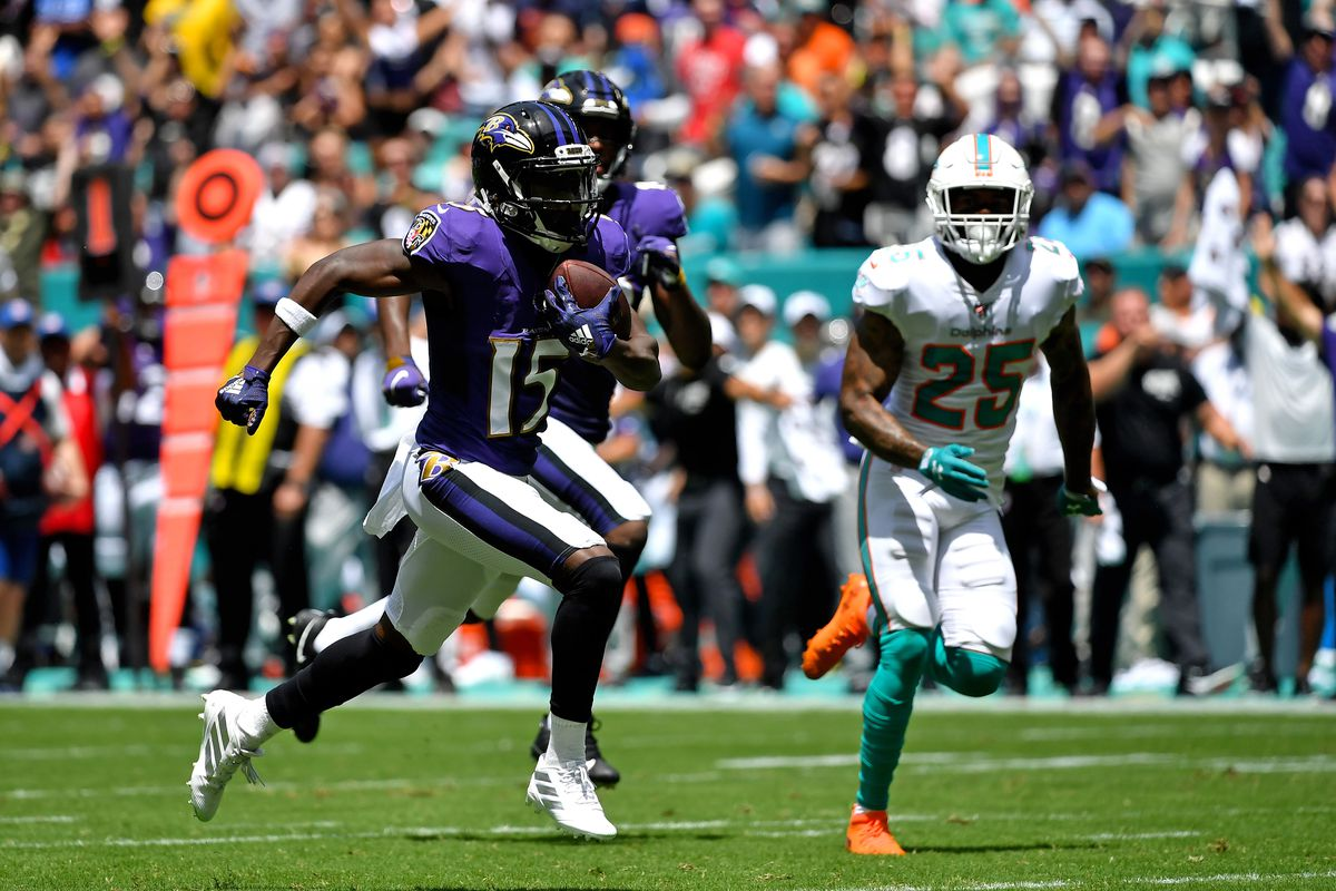 Baltimore Ravens wide receiver Marquise Brown runs for a touchdown against Miami Dolphins cornerback Xavien Howard during the first half at Hard Rock Stadium.