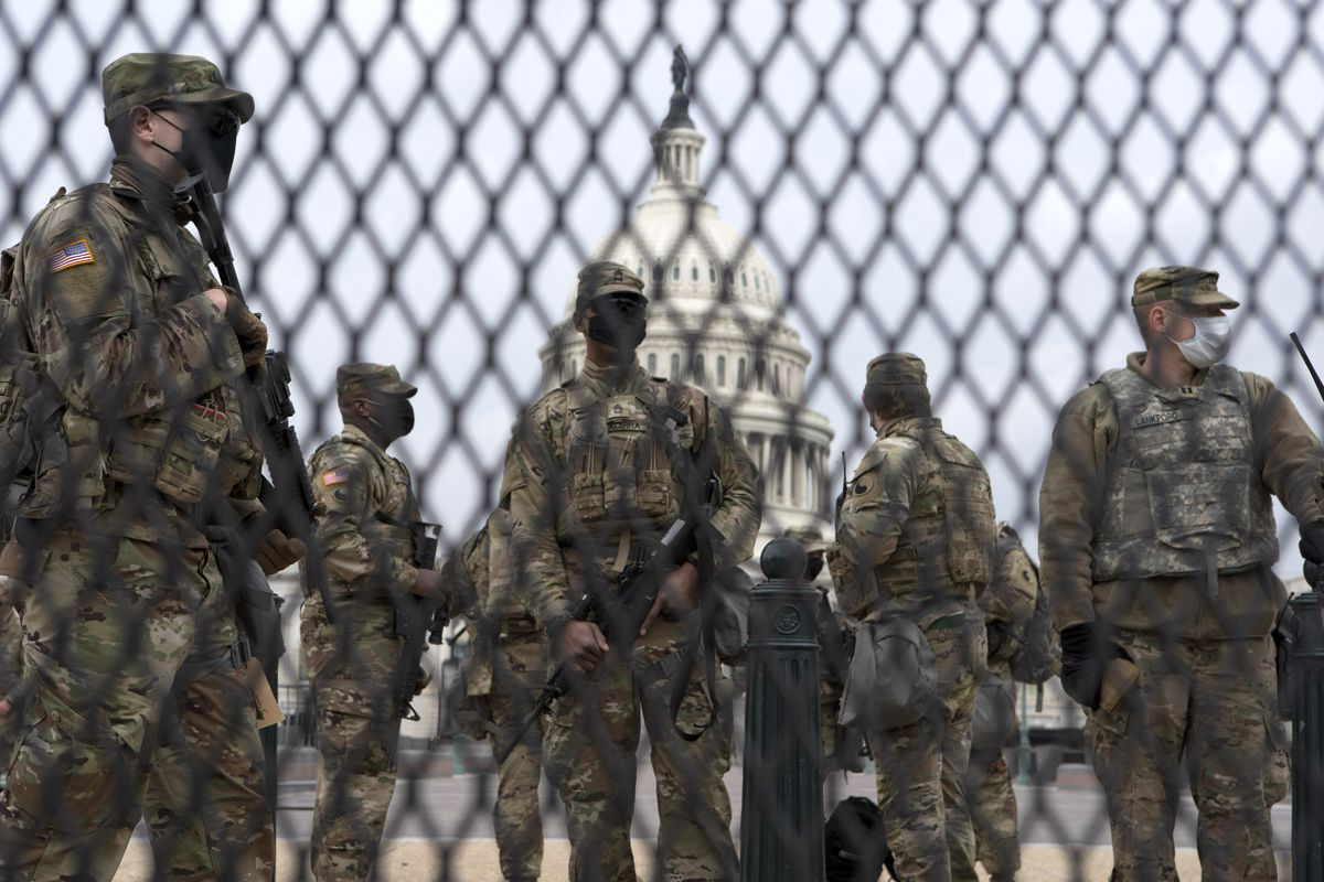 Members of the National Guard stand guard outside the U.S. Capitol in Washington Friday, Jan. 15, 2021.