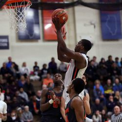 Oak Park's Chase Robinson (15) scores against Evanston during their 79-69 loss in Oak Park,  Saturday, February 2, 2019. | Kevin Tanaka/For the Sun Times