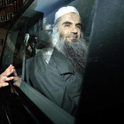 FILE - In this Tuesday, April 17, 2012 file photo, Abu Qatada is driven away after being refused bail at a hearing at London's Special Immigration Appeals Commission, which handles deportation and security cases, in London. Al-Qaida's North African affiliate offered to free a British hostage if London allowed radical cleric Abu Qatada to leave Britain for another country. Al-Qaida in the Islamic Maghreb in a statement posted Monday, April 30, 2012 on a militant website said it would release Stephen Malcolm if Abu Qatada were let go.