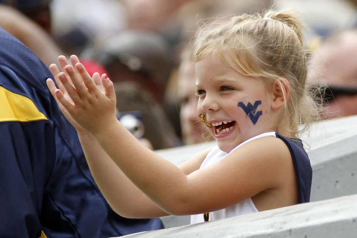 PITTSBURGH, PA - SEPTEMBER 01:  A young West Virginia Mountaineers fan cheers during the game against the Marshall Thundering Herd on September 1, 2012 at Mountaineer Field in Morgantown, West Virginia.  (Photo by Justin K. Aller/Getty Images)