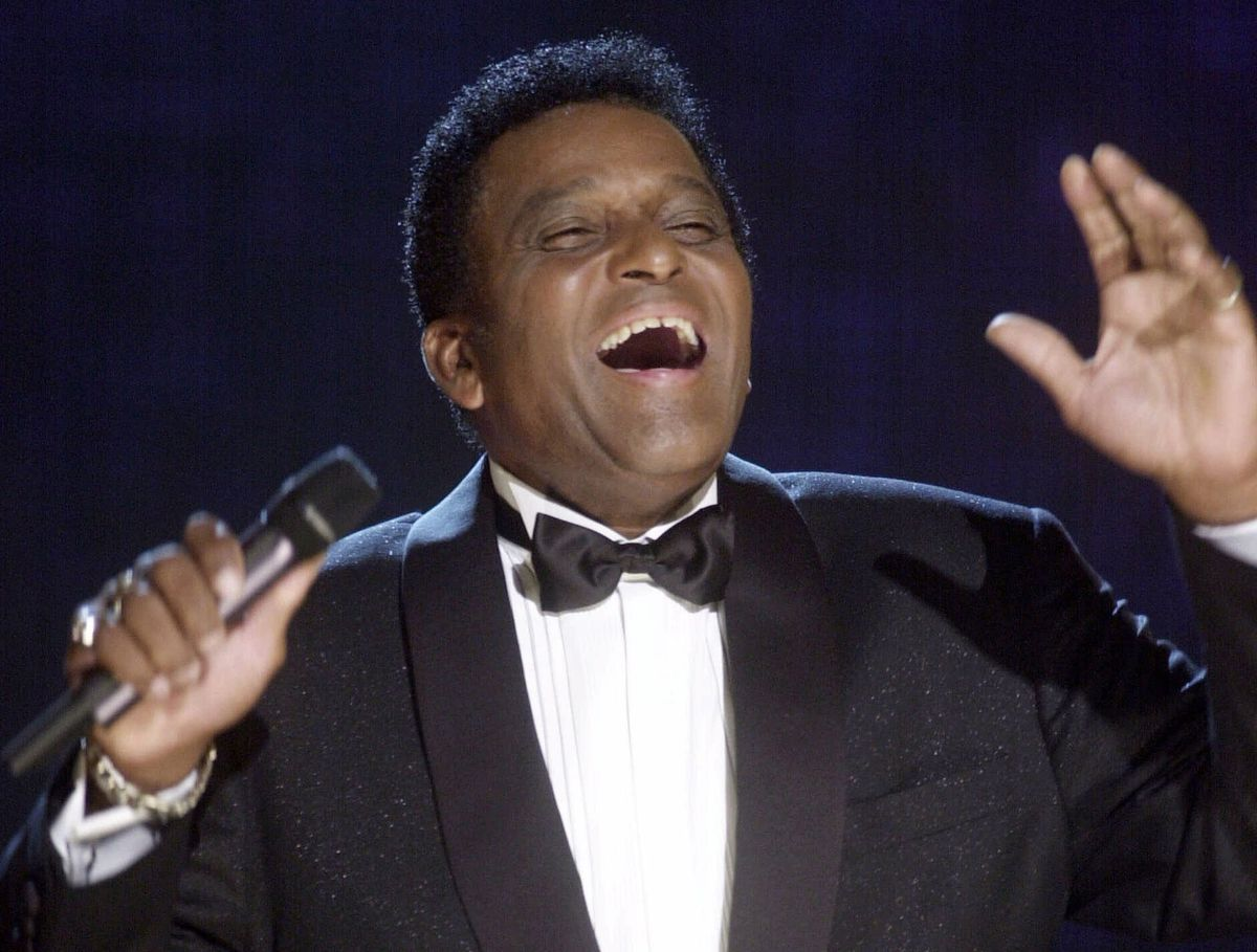 In this Oct. 4, 2000, file photo, Charlie Pride performs during his induction into the Country Music Hall of Fame at the Country Music Association Awards show at the Grand Ole Opry House in Nashville, Tenn.