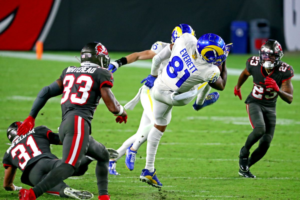 Los Angeles Rams tight end Gerald Everett (81) runs the ball against Tampa Bay Buccaneers free safety Jordan Whitehead (33) during the third quarter at Raymond James Stadium.