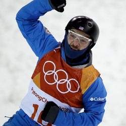 Jonathon Lillis, of the United States, reacts to his run during the men's aerial qualifying at Phoenix Snow Park at the 2018 Winter Olympics in Pyeongchang, South Korea, Saturday, Feb. 17, 2018. (AP Photo/Gregory Bull)