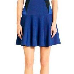 "Renee Fit and Flare Knit Dress, $398 at <a href=""http://www.dvf.com/renee-fit-and-flare-knit-dress/D7358458U13.html?dwvar_D7358458U13_size=L&dwvar_D7358458U13_color=BLKWT#cgid=dresses"">Diane Von Furstenberg</a>."