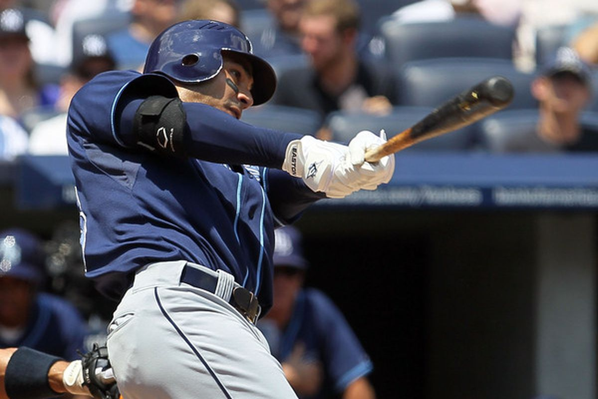 NEW YORK - JULY 18:  Carlos Pena #23 of the Tampa Bay Rays follows through on a first inning three run home run against the New York Yankees on July 18 2010 at Yankee Stadium in the Bronx borough of New York City.  (Photo by Jim McIsaac/Getty Images)