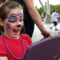 Moira McLean reacts to seeing her face painted as a purple gorilla at Five-O Fest, a free community festival hosted by the Utah Anti-Bullying Coalition, Safe2Help and the Salt Lake City Police Foundation outside of the Public Safety Building in Salt Lake City on Saturday, May 31, 2014.